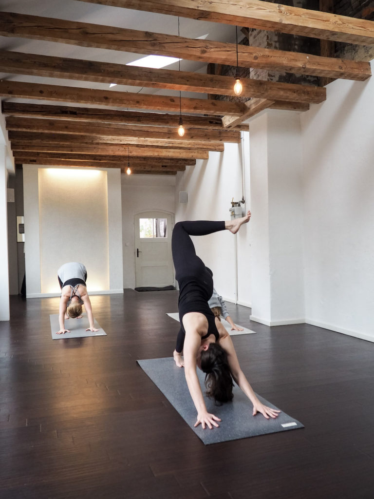Three yogis during their practice - ideas for sustainable Valentine's Day presents